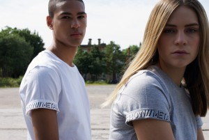 Male and female models wearing plain white and grey SHOW//METAL T-Shirts